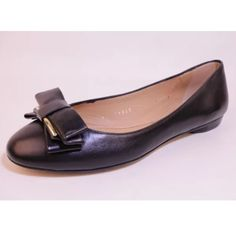 "100% authentic Salvatore ferragamo leather flats Brand new 100% authentic Salvatore ferragamo black leather flats with gold accent on bow that reads ""Salvatore ferragamo"". Size 7.  No trades. Salvatore Ferragamo Shoes Flats & Loafers"