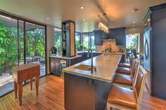 Staged to sell this one of a kind zen style home will take your breath away. The Amazing Cook's kitchen with custom features will entice you to invite all your friends over to experience your amazing talents.