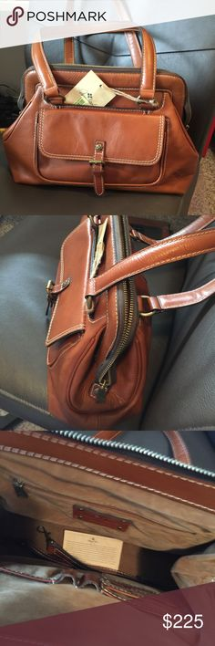 NWT Patricia Nash heritage Beautiful tan brown leather  Style #p03301 Veg tan  3 pockets on the outside zip top 14 x 10 x 5. There's in a long strap too Patricia Nash Bags Shoulder Bags