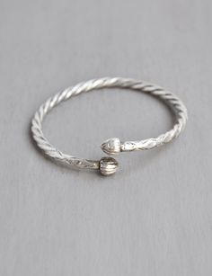 Vintage Sterling Silver Torque Bangle - West Indies Caribbean tribal slave bracelet with acorn finials - heavy solid metal by CuriosityCabinet on Etsy