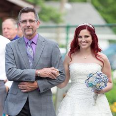 Father walking his daughter down the aisle.   Wedding Ceremony Photo by Justina Roberts. Cleveland, OH.