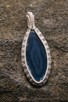 Blue Dyed Agate Slab with Fern Leaf Silver  Plated Wire Wrap $50.00 by WanderingRockDesigns  It takes 4 hours to complete this style of wire wrap with double bail and wrapped backside.