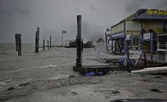 """Hurricane Irma Hits Florida Islands As Class four Storm The damaged docks at Whale harbour in Florida Keys Miami:  Hurricane Irma's eyewall slammed into the lower Florida Keys Sunday, lashing the island chain with fearsome wind gusts, the US National Hurricane Center said. The eye of the Category 4 storm was 15 miles (24 kilometers) southeast of Key West as of 7:00 am local time (1100 GMT), bringing maximum sustained winds of 130 miles per hour and threatening dangerous storm surges.  """"This…"""