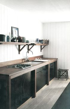 = black and wood kitchen = Christian Liaigre