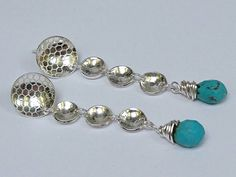 Check out this item in my Etsy shop https://www.etsy.com/uk/listing/512421022/sterling-silver-handmade-turquoise-drop