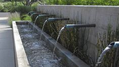 Custom Water Feature  http://www.concreteworks.com/#/products/commercial/water_features/custom_water_feature/