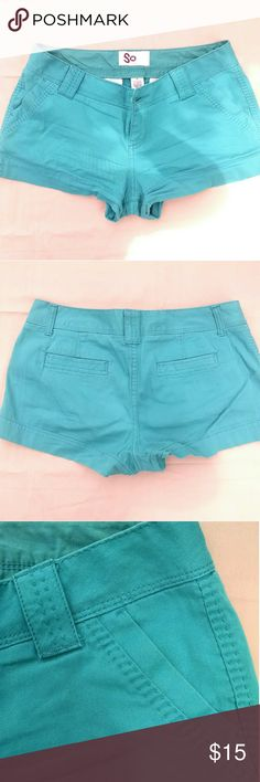 Juniors' Teal Cotton Shorts Soft cotton shorts in great condition and in a gorgeous teal color! Features beautiful stitching, front and back pockets, and a plastic teal button closure. SO Shorts