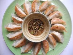 Salmon Gyoza - Amazing salmon filled dumplings with sesame soy dipping sauce. #gyoza #dumplings #potstickers #japanese #ginger #garlic