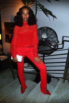 Solange owns this all red ensemble at a New York Fashion Week party.