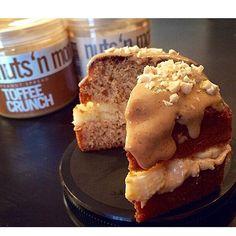 """""""Dessert should always include 2 kinds of @nutsnmore. Wouldn't you agree #NutNation?! @ladyfit stuffed an @eatmeguiltfree blonde with banana and WHITE CHOCOLATE PEANUT BUTTER and then topped it off with TOFFEE CRUNCH PEANUT BUTTER for an extra protein packed treat! --------------------------------------- #nutnation #nutsnmore #peanutbutter #poweredbypeanutbutter #fueledbynutbutter #protein #healthy #fitfam #fitfood #macros #orange4life #fitness #muscle #yum #delicious #snack #breakfast…"""