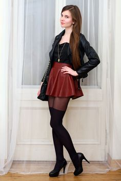 Leather jacket and red leather skirt with tights and heels