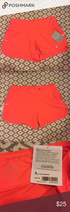 NWT Athleta Ready Set shorts Lightweight, super comfortable shorts with liner. Has side pockets and reflective stripes. I love the fit of these shorts! If you're a runner and are looking for shorts with great visibility, these are for you!  bundle and save! Athleta Shorts