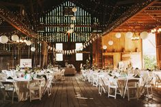 Stunning barn wedding decorations   Claire & Greg's Whimsical Dance Party Farm & Vineyard Wedding in Virginia   Images: Nessa K Photography