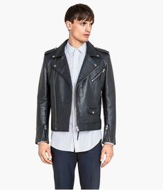 PREMIUM QUALITY. Biker jacket in leather with a diagonal zip at front. Snap fasteners on lapels and shoulder tabs with snap fastener. Three pockets with zip, smaller pocket with flap and snap fastener, and one inner pocket. Zips at cuffs. Lined.