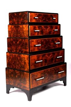 Pierre 5 drawer art deco dresser. The piece shows walnut burl wood with a black lacquer construction. The piece has a wonderful flair for Art Deco glamour.