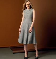 V9025 Dress has seam detail, fitted, dropped waist bodice, and invisible back zipper. #voguepatterns