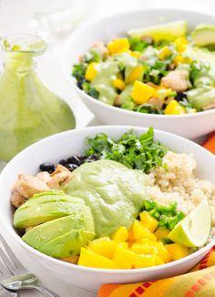 Chicken Quinoa Bowls Recipe with quinoa, kale, chili chicken, mango, black beans, cilantro, jalapeños and healthy Cilantro Avocado Dressing.   ifoodreal.com