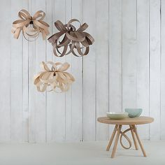 Natural woods and bold design can add a little something to your sleep sanctuary like these beautiful ceiling lamps from John Lewis