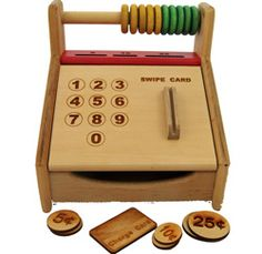 Chaa Ching!  We love this beautiful wooden cash register!!  Don't forget to download the paper money on www.pureplaykids.com $49.95