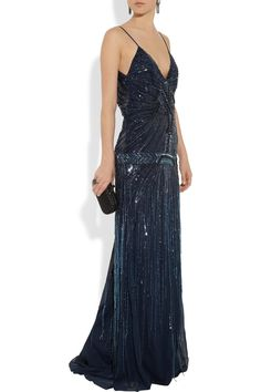 The 1920s is often associated with rising skirt heights, but for formal occasions a full length gown was still de rigeur. The spaghetti straps, dropped waist, beading and v front and back of this Roberto Cavalli gown are totally 1920s.