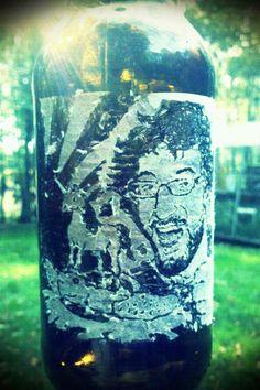 scratched portraits on beer bottles