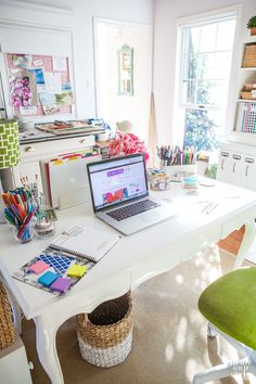 Colorful office space we love! Decorating with white and bright is a great way to stay energized throughout the day!