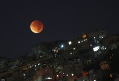 SYRIA: The supermoon shone brightly over war-torn Syria overnight, with residents of Damas...