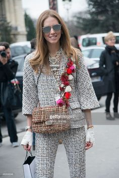 Fashion Blogger of The Blonde Salad Chiara Ferragni wears a suit, gloves, clutch by Chanel and Dior sunglasses on day 3 of Paris Haute Couture Fashion Week Spring/Summer 2015, on January 27, 2015 in Paris, France.