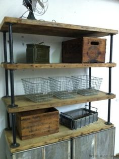 pipe and salvaged wood shelving. this doesn't appear to take you to any directions, but it seems simple enough.