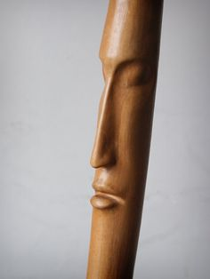 Head hand-carved wooden walking stick