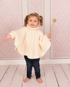 ROLL NECKED PONCHO WITH CABLE RIB AND SLEEVE CUFFS
