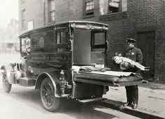 Police officer carries unconscious child, believed to be a contagious case, to an awaiting ambulance, ca. More Historic Photos From the NYC Municipal Archives - In Focus - The Atlantic Police Cars, Police Officer, Police Uniforms, Sick Kids, Historical Images, Emergency Vehicles, City Photography, Fire Department, Ford Trucks