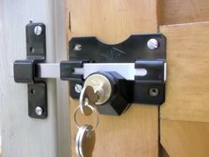 Home Accessories, The Charming Design Of The Barn Door Locks With The Combination White And Black Color Of Cute Locks On The Wodoen Matter And Brown Color Of Barn Door: The Amazing Design Of The Barn Door Locks With The Exciting Style Barn Door Locks, Gate Locks, Wooden Storage Buildings, Drive Gates, Gate Latch, Old Garage, Security Door, Backyard Projects, Home Accessories