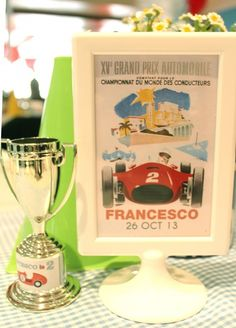 Vintage Race Car Birthday Party Framed vintage race car poster and a mini trophy for the table centerpiece