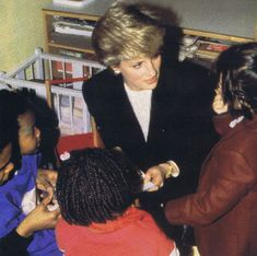 January 22, 1987:  Princess Diana visiting the St. John's Day Community Day centre in Brixton.    Diana's visit to the day centre that was a women's refuge, came as patron of the Barnardo's charity,