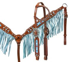 Showman ® Medium leather headstall and breast collar set with beaded inlay and turquoise sting ray print fringe. This headstall and breast collar set feature medium leather with turquoise beaded inlay with feather design and colored studs. Breast collar features turquoise sting ray print fringe from www.spoilmhyhorse.com