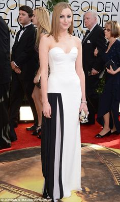 1-12-14.   Modern lady: Downton Abbey's Laura Carmichael sported a black and white sleek strapless gown which looked a far cry from her TV alter ego Lady Edith