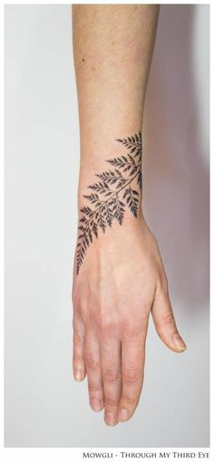 Fern leaf tattoo on the right wrist, titled 'Horticulture Fluidity'. Done by Mowgli