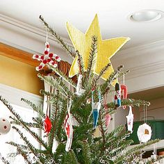 Felt Star Tree Topper : A big yellow star is a traditional tree topper, but when made from felt, this ornament becomes the literal star of the show. Cut two identical stars from yellow felt and stitch them together. Stick the star between two top branches. Don't worry about the star being perfect -- imperfections just add to the childish charm.