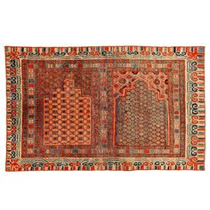 Rare and Early Khotan Rug with Two Niches | From a unique collection of antique and modern chinese and east asian rugs at https://www.1stdibs.com/furniture/rugs-carpets/chinese-rugs/