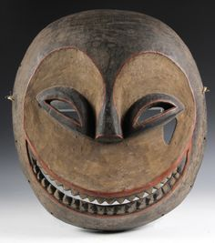 "Ibibeo People, Southern Nigeria, Eket Mask, in carved and painted wood, circa 1960. 18"" x 16"""