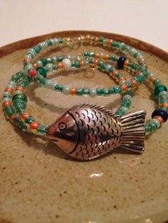 A personal favorite from my Etsy shop https://www.etsy.com/listing/230525036/multicolor-fish-beaded-bracelet