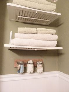 Another way to reuse the shutters. Make them into shelves for the bathroom.