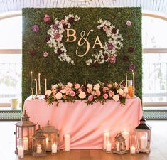 Sweetheart table with backdrop for wedding reception