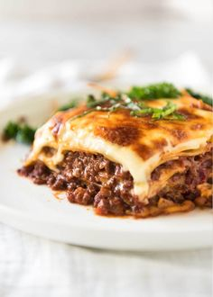 One of the most beloved foods in the world, this is a traditional Italian Lasagna made with Bolognese ragu and cheese sauce. Recipe video and step photos included!