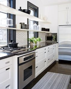 Kitchen design: Open shelves in front of kitchen windows [PHOTO: Stacey Brandford}