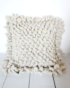 Mexchic's wool bouclé grande floor pillows are handwoven in Mexico with 100% virgin earth friendly wool in a chunky, plush style. The artisan who weaves them, cleans, spins and dyes his own wool and t