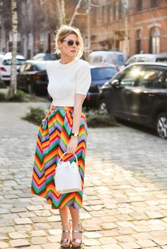 white top and rainbow striped skirt