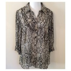 Feminine Black and Light Gray Tunic This top has 3/4 sleeves, and is Polyester.  The front has a ruffle around the front. Tops Blouses