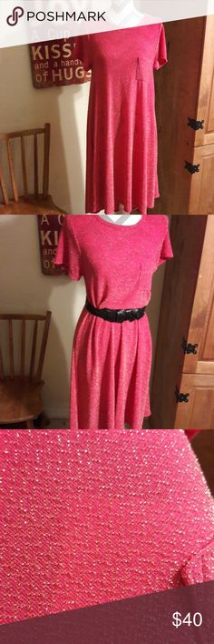 LULAROE Sparkly Carly💖 Add some sparkle to your wardrobe with this Carly from lularoe! Super comfy. Wear like a dress or with some leggings. The color seems to be a darker coral or darker peach with gold woven in the material. Gently used.  Worn and washed once. In great condition. I love reasonable offers or bundle to save! LuLaRoe Dresses Asymmetrical
